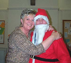 Carol Brookhouse making sure to keep Father Christmas happy.