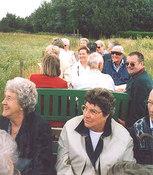 On the  train to the vineyard.  In front,  Peggy Smith and Sheila Somerton.  Also in the photo: Ann Smith, Roger Russell and Jenny Saunders.